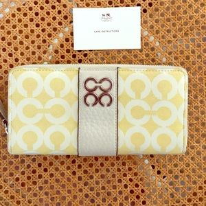 Coach yellow fabric with leather zip up wallet